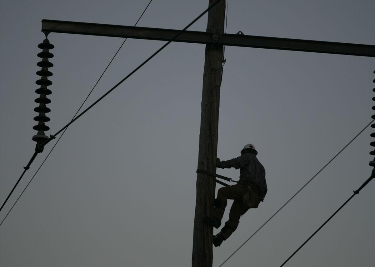 Lineman climbing a pole